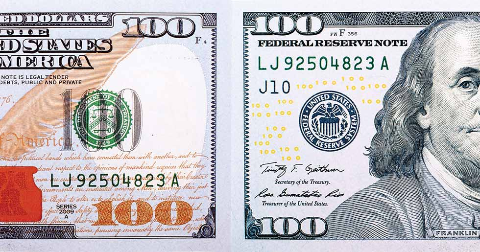 two halves of a 100 bill